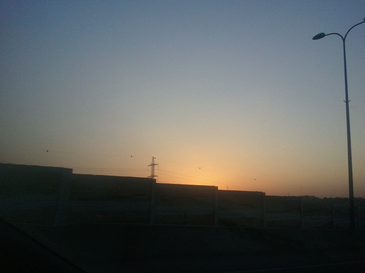 Sunset over the Israeli West Bank barrier